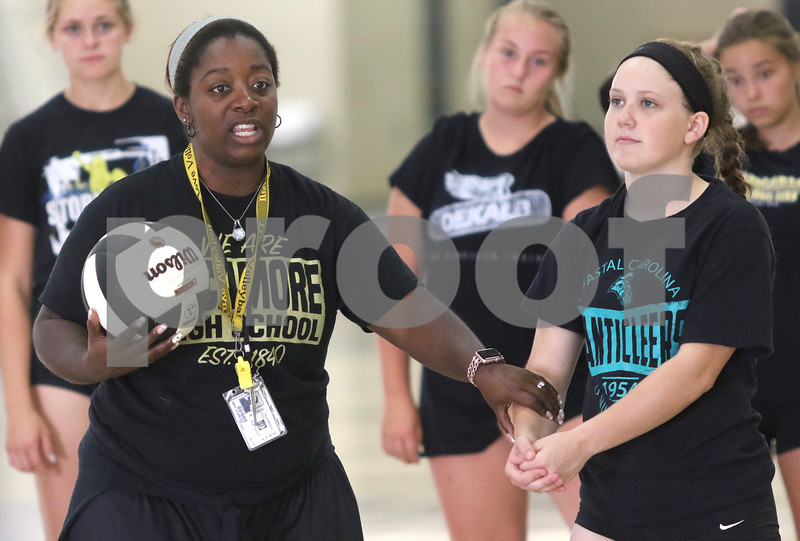 dc.sports.0818.sycamore volleyball ADV04