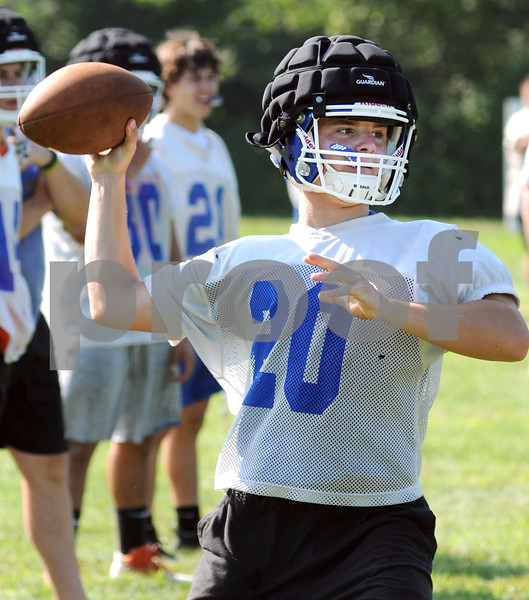 Genoa-Kingston quarterback Justin Peters throws a pass during practice on Monday at Walcamp Retreat in Kingston.  Steve Bittinger - For Shaw Media.