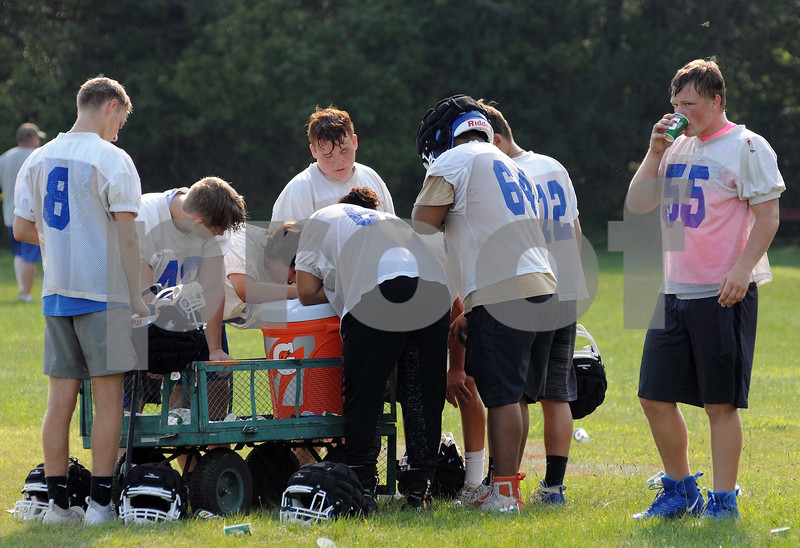 Genoa-Kingston football players take a water break during practice on Monday at Walcamp Retreat in Kingston.  Steve Bittinger - For Shaw Media.