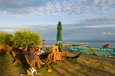 People relax in a bar overlooking Puck Bay, Hel Peninsula, Baltic Sea, Poland