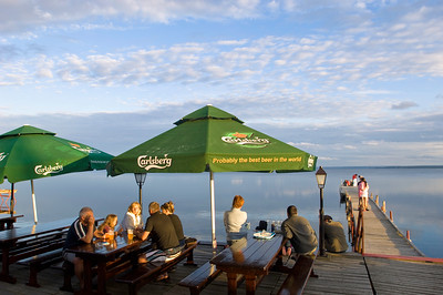 People relax in a bar overlooking Puck Bay, early evening, Hel Peninsula, Baltic Sea, Poland