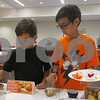"Aimee Barrows - for Shaw Media<br /> Noah Thompson, left, 8, and Levi Thompson, 11, try new fruits during the ""Funky Fruits"" event Saturday at the DeKalb Public Library."