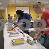 """Aimee Barrows - for Shaw Media<br /> Patrons line up to try new fruits during the """"Funky Fruits"""" event Saturday at the DeKalb Public Library."""