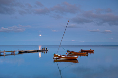 Boats moored by wooden jetty in moonlight, Hel Peninsula, Baltic Sea, Poland