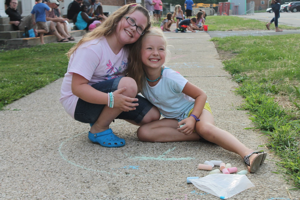 . Brooklyn Baka, 8, and Katrina Uncapher, 8,  were part of  group of parents and students who gathered at Longfellow Elementary School in Eastlake on Aug. 15, to draw inspirational messages on the schools walkways to welcome students back on the first day of school. Kristi Garabrandt - The News-Herald