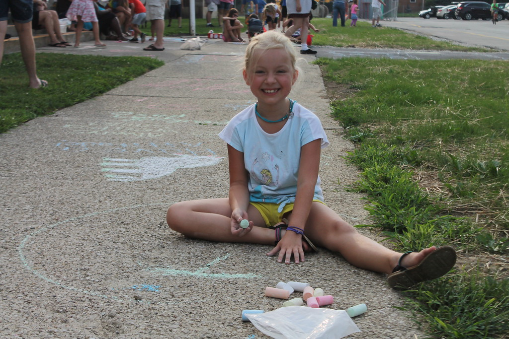 . Katrina Uncapher, 8,  was  part of  group of parents and students who gathered at Longfellow Elementary School in Eastlake on Aug. 15, to draw inspirational messages on the schools walkways to welcome students back on the first day of school. Kristi Garabrandt - The News-Herald