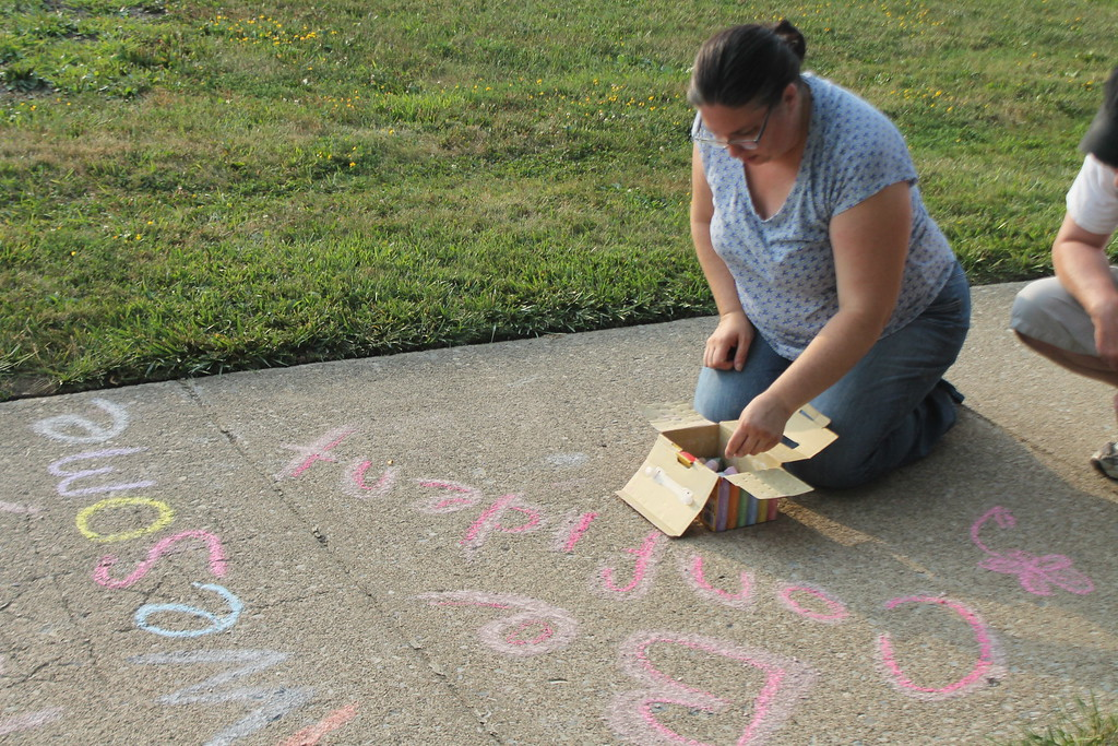 . Angela Barbarino-Schmidt,organizer of the Chalk the Walk event at Longfellow Elementary School in Eastlake,  was one of many parents and students who gathered on Aug. 15, to draw inspirational messages on the schools walkways to welcome students back on the first day of school. Kristi Garabrandt - The News-Herald