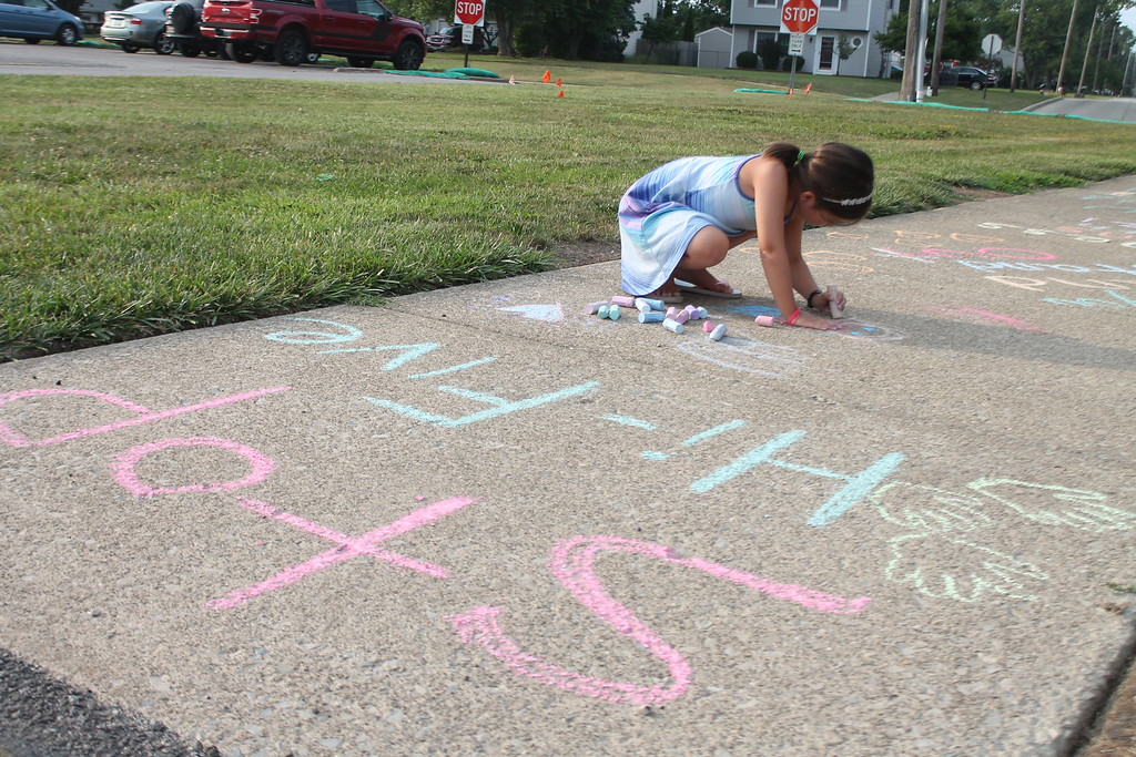 . Ella Coiner, 5,  was  part of  group of parents and students who gathered at Longfellow Elementary School in Eastlake on Aug. 15, to draw inspirational messages on the schools walkways to welcome students back on the first day of school. Kristi Garabrandt - The News-Herald