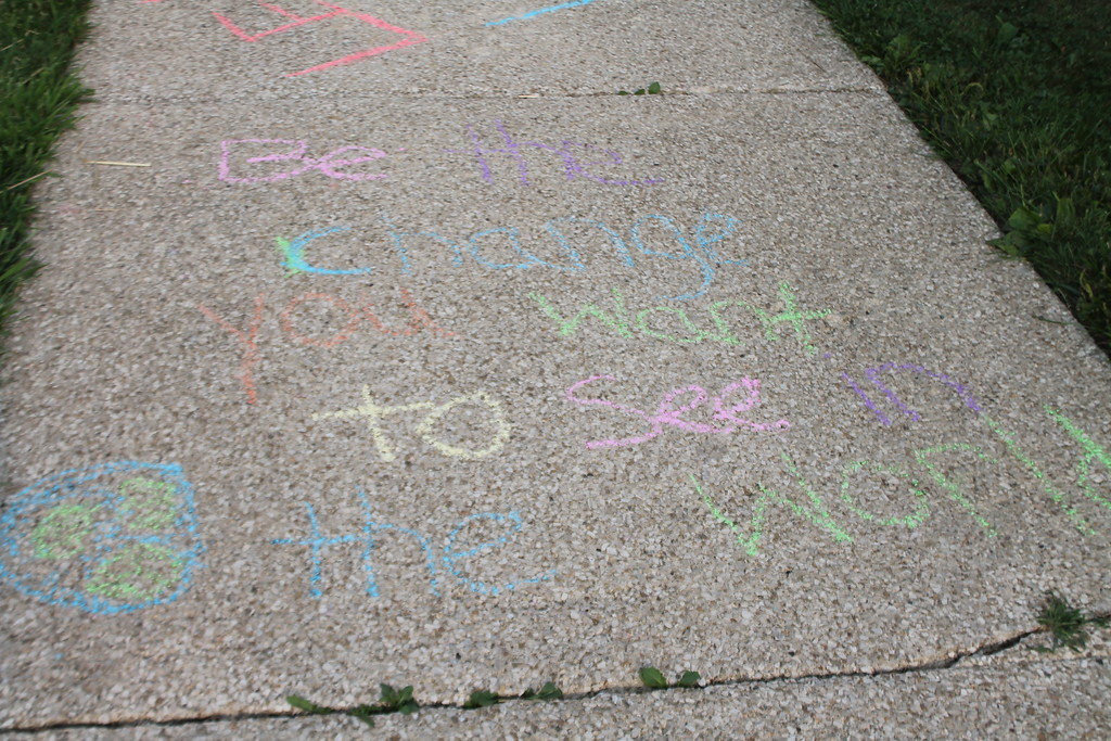 ". ""Be the Change you want to see in the World\""  was one of the messages that greeted students on their first Day back to school at Longfellow Elementary in Eastlake on Aug. 16.  A group of parents and students had gathered at the school on Aug. 15, to draw inspirational messages on the school walkways to welcome the students back. Kristi Garabrandt-The News-Herald"