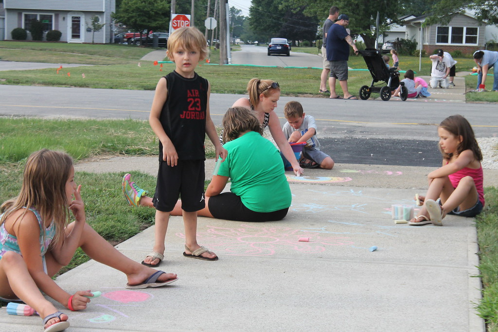 . A group of parents and students gathered at Longfellow Elementary School in Eastlake on Aug. 15, to draw inspirational messages on the schools walkways to welcome students back on the first day of school. Kristi Garabrandt - The News-Herald