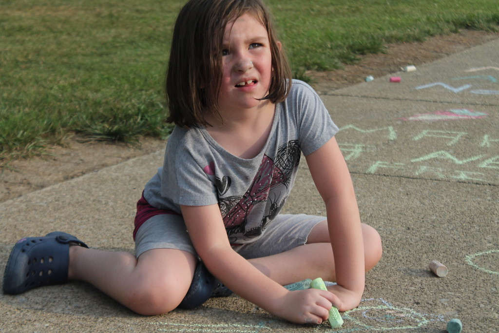 . Estella Schmidt, 6,   was  part of  group of parents and students who gathered at Longfellow Elementary School in Eastlake on Aug. 15, to draw inspirational messages on the schools walkways to welcome students back on the first day of school. Kristi Garabrandt - The News-Herald