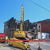 B & B Wrecking begins the demolition of the Thistle building at 700 Broadway Ave., Aug. 15, 2017. (Eric Bonzar/The Morning Journal)