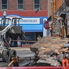 Bystanders watch from the Northern Institute of Cosmetology as B & B Wrecking demolishes the rear portion of Thistle building at 700 Broadway Ave., Aug. 15, 2017. (Eric Bonzar/The Morning Journal)