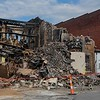 The demolition crew from B & B Wrecking wrapped up day one of the Thistle building razing about 4:30 p.m., Aug. 15, 2017. The crew is scheduled to return Aug. 16, to continue tearing down the structure destroyed by an Aug. 6, early morning fire. (Eric Bonzar/The Morning Journal)