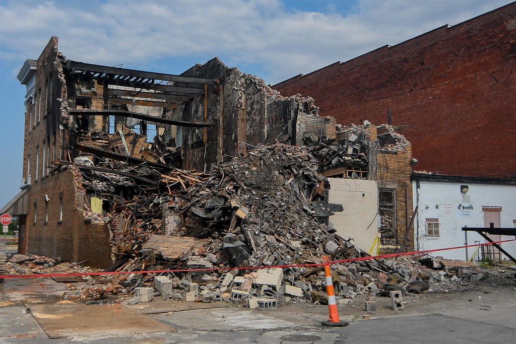 . The demolition crew from B & B Wrecking wrapped up day one of the Thistle building razing about 4:30 p.m., Aug. 15, 2017. The crew is scheduled to return Aug. 16, to continue tearing down the structure destroyed by an Aug. 6, early morning fire. (Eric Bonzar/The Morning Journal)