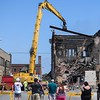 Bystanders watch as B & B Wrecking demolishes the Thistle building at 700 Broadway Ave., Aug. 15, 2017. (Eric Bonzar/The Morning Journal)