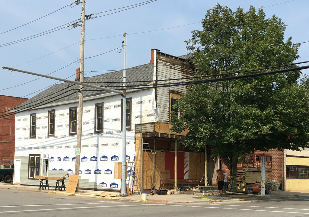 . Richard Payerchin � The Morning Journal  A crew from T.J. & Sons of Avon Lake work on rebuilding the former Nelis Wallpaper building at 858 Broadway on Aug. 15, 2018. The restoration effort is part of several property transfers and progress with building plans on and around Broadway in downtown Lorain.