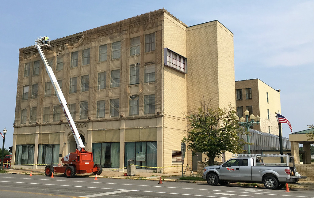 . Richard Payerchin - The Morning Journal  Workers from Coon Restoration & Sealants Inc. take measurements ahead of construction on the Broadway Building, 301 Broadway, on Aug. 15, 2018. The work is one of several projects with building owners who have plans for their buildings on and around Broadway in downtown Lorain.