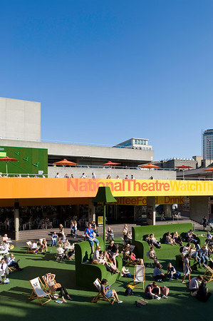 People relax on warm summer day by Royal National Theatre, London, United Kingdom
