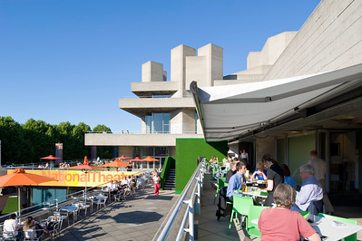 People relax on terrace bar of Royal National Theatre, London, United Kingdom