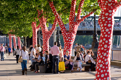 Trees covered in polka dots to celebrate exhibition by Yayoi Kusama at Hayward Gallery, Southbank Centre, London, United Kingdom