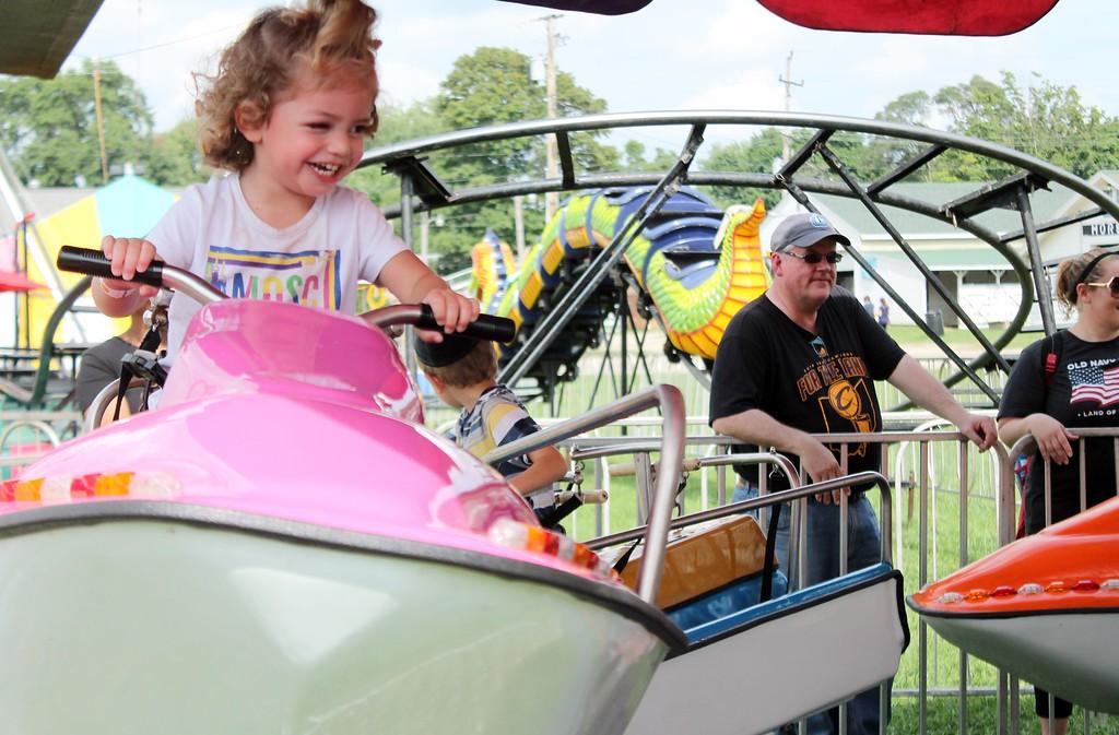 . Kristi Garabrandt � The News-Herald <br> Rachel, 2 1/2 of Cleveland Heights enjoys the boat ride at the fair.
