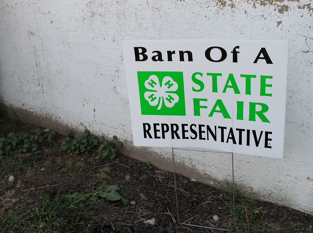 . Kailee Leonard � The News-Herald <br> 4H members need to quailfy to attend and compete at the Ohio State Fair. This sign is proudly displayed outside several barns.