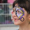 Kristi Garabrandt — The News-Herald <br> Amanda Teter, 7, of Mentor, walks the fair with a purple butterfly painted on her face.