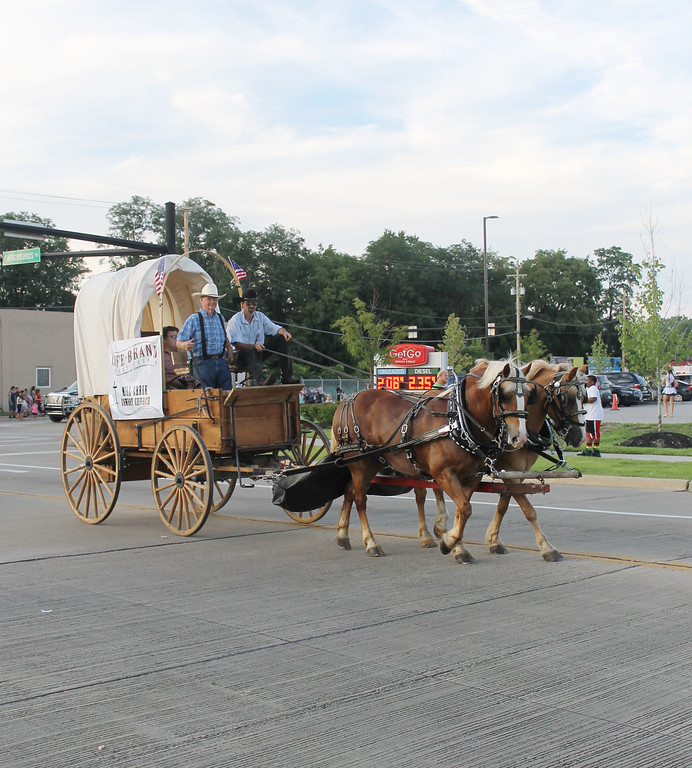 . Kailee Leonard � The News-Herald <br> Life Brand Church and their haflinger team drives during the annual Lake County Fair parade.