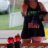 Kristi Garabrandt — The News-Herald <br> Alana Cook, 10, of Mentor, attempts to win a gold fish by throwing balls into fish bowls.