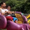 Kristi Garabrandt — The News-Herald <br> Luis Rodriguez of Painesville enjoys the fair rides with Demarezell Cruz of Ashtabula.