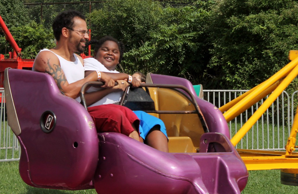 . Kristi Garabrandt � The News-Herald <br> Luis Rodriguez of Painesville enjoys the fair rides with Demarezell Cruz of Ashtabula.�