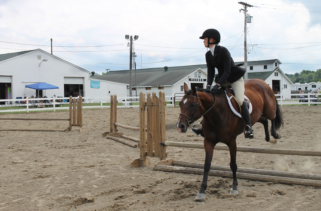 . Kailee Leonard � The News-Herald <br> Julia Beasley competes with her mare during her equitation over fences class.