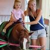 Kristi Garabrandt — The News-Herald <br> Brooklyn Ruff, 1 1/2, of Madison enjoys the pony rides with her mom Leanna Ruff.