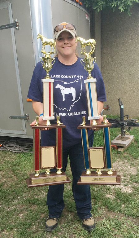 . Kailee Leonard � The News-Herald <br> Senior Saddle Horse President, Renee Daugherty, holds the trophies for champion and reserve champion for the trail competition.