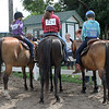 Kailee Leonard — The News-Herald <br> Three fellow 4H members hang out during the Walk-Trot contesting competition held Wednesday morning.