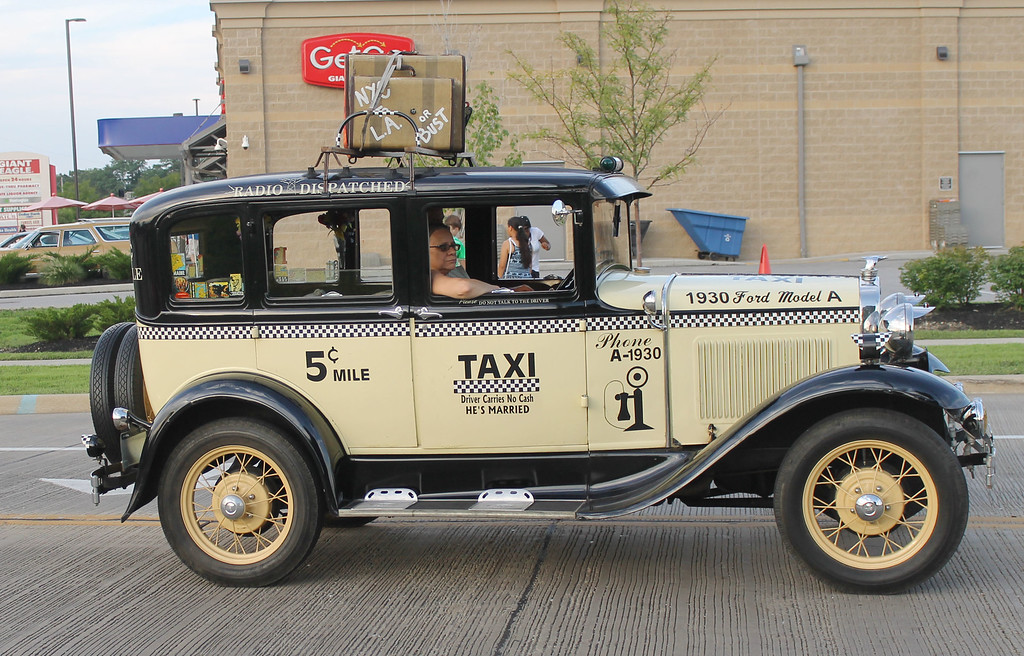 . Kailee Leonard � The News-Herald <br> Several model cars were displayed during the annual Lake County Fair parade. This model is suppose to replicate a 1930 taxi cab.