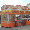 Kailee Leonard — The News-Herald <br> The ever popular Roll'n B helps two customers. The stand is known for their loaded cheese fries.