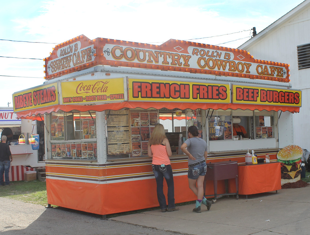 . Kailee Leonard � The News-Herald <br> The ever popular Roll\'n B helps two customers. The stand is known for their loaded cheese fries.