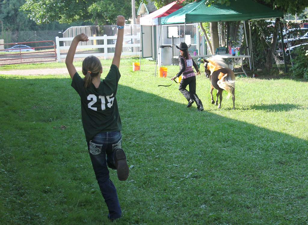 . Kailee Leonard � The News-Herald <br> Gia Dadonte cheers on fellow 4H member Zoey Brown as she practices for the in hand trail competition.