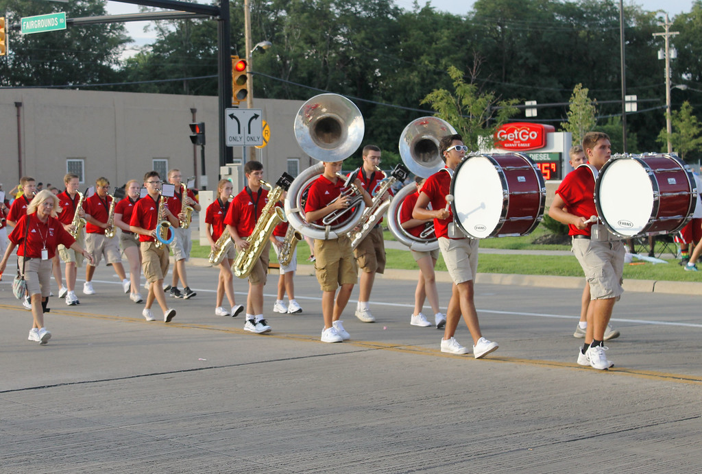 . Kailee Leonard � The News-Herald <br> Perry High School marching band marches down Fairground Road in the annual Lake County Fair parade.