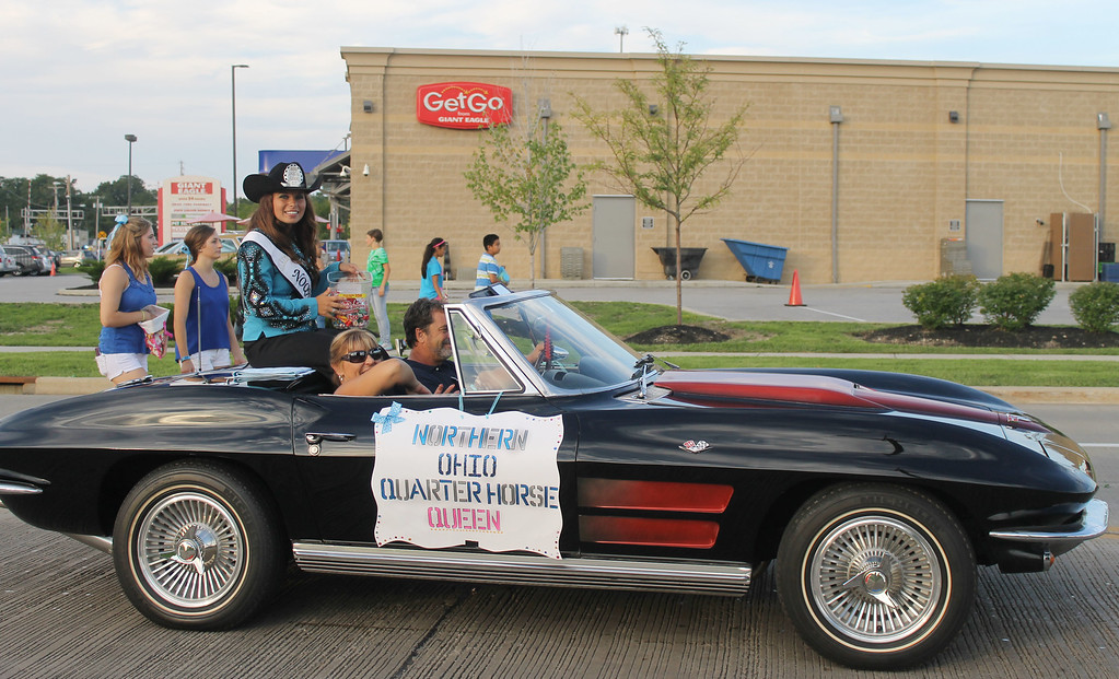 . Kailee Leonard � The News-Herald <br> Northern Ohio Quarter Horse Queen, Brooke Harrison rides and passes out candy in the annual Lake County Fair parade Wednesday evening.