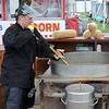 Kristi Garabrandt — The News-Herald <br> Christen Deeds of Mentor makes kettle korn for Pap's Kettle Korn.