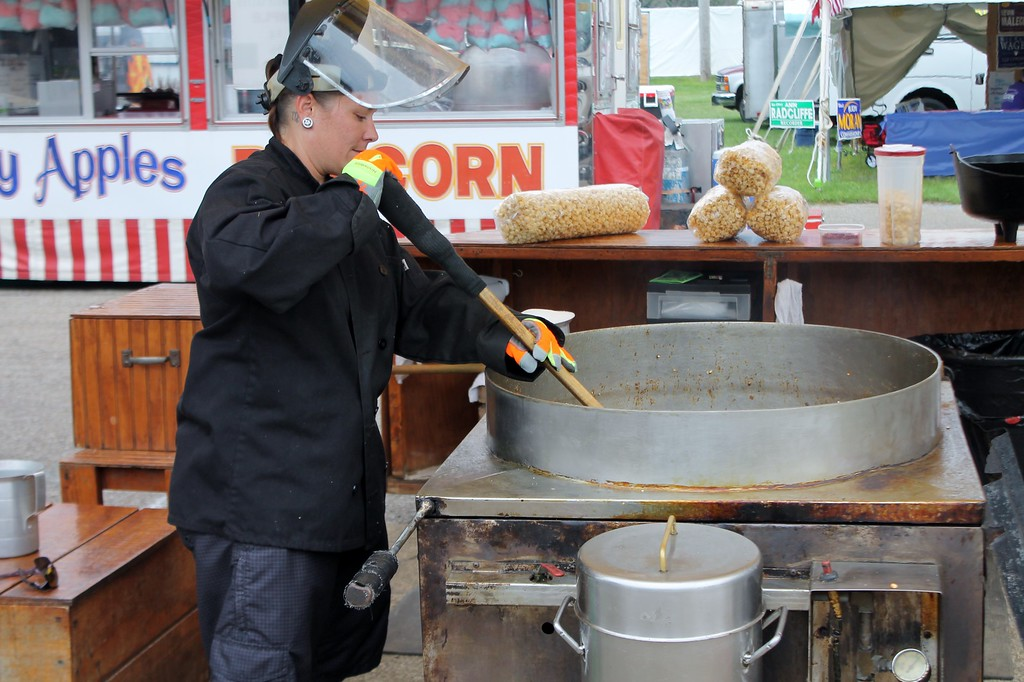 . Kristi Garabrandt � The News-Herald <br> Christen Deeds of Mentor makes kettle korn for Pap\'s Kettle Korn�.