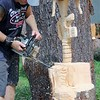 Kristi Garabrandt — The News-Herald <br> Matthew Hannah owner of Insane Chain in Eastlake carves the Solder's Cross during his chain saw carving demonstration at the fair.