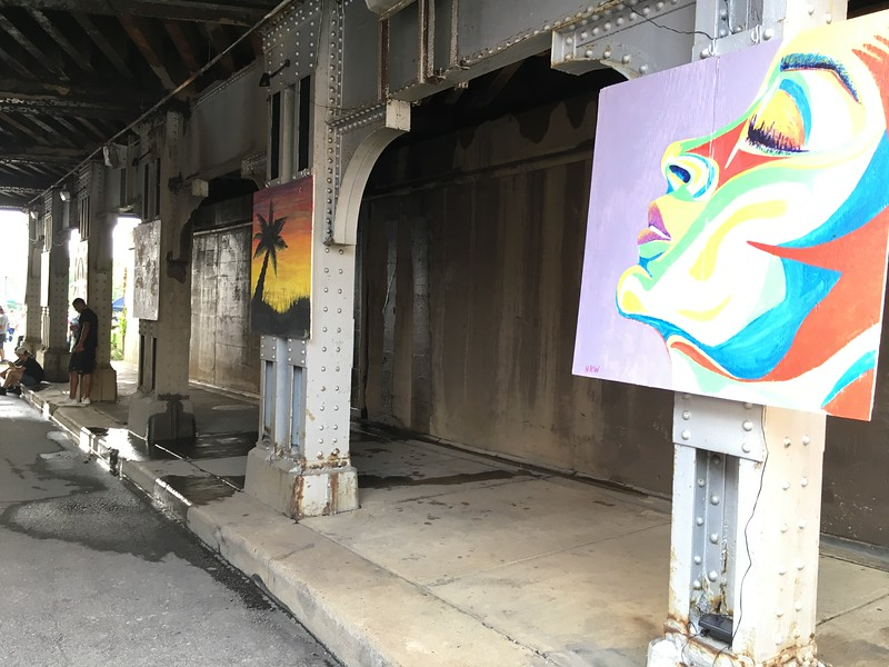 Richard Payerchin — The Morning Journal <br /> Artists used four-foot-by-four-foot panels of plywood to create paintings that adorned the railroad underpass in downtown Elyria for the Garford Arts Fest. Hundreds turned out for the inaugural festival on Aug. 18, 2018.