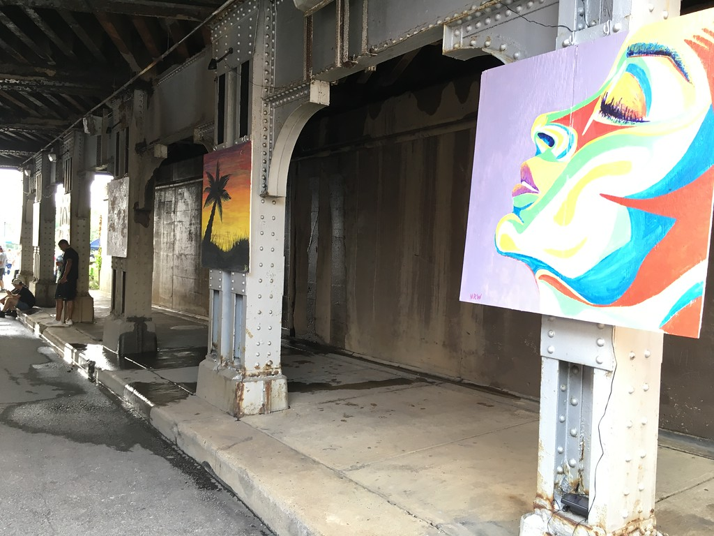 . Richard Payerchin � The Morning Journal  Artists used four-foot-by-four-foot panels of plywood to create paintings that adorned the railroad underpass in downtown Elyria for the Garford Arts Fest. Hundreds turned out for the inaugural festival on Aug. 18, 2018.