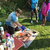 Richard Payerchin — The Morning Journal <br /> Artist Paul Pay uses spray paint to create a planetary outer space scene on canvas at the Garford Arts Fest, which brought food, artists and music to Kerstetter Way in downtown Elyria. Hundreds turned out for the inaugural festival on Aug. 18, 2018.