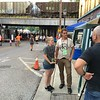 Richard Payerchin — The Morning Journal  <br /> Garford Arts Fest co-organizers Andrea Repko and Steve Riggle speak for videographer Larry Reed while behind them people enjoy the festival and a train rolls overhead. Hundreds turned out for the inaugural festival on Aug. 18, 2018.