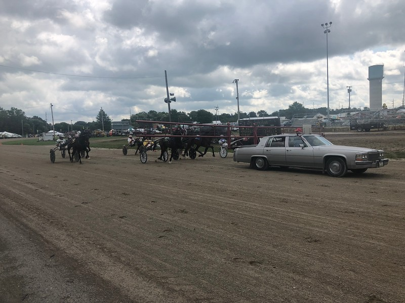 Briana Contreras — The Morning Journal <br> A car leads the horses during the Harness Race at the Lorain County Fair on Aug. 21 at the Fairgrounds in Wellington.